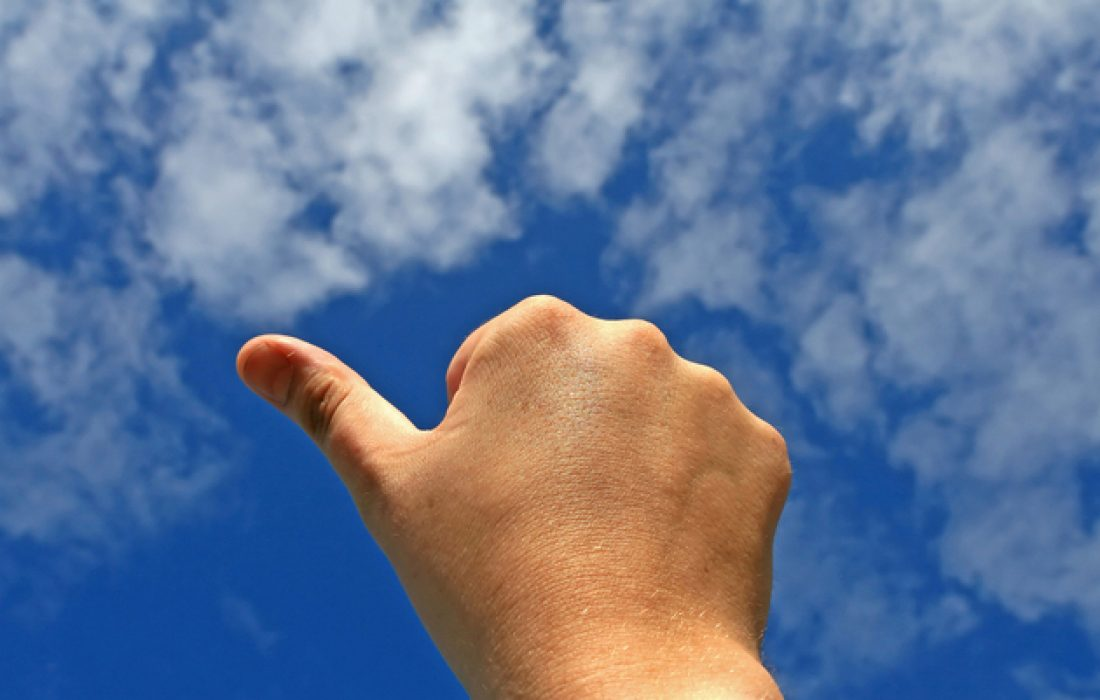 Thumbs up in business or life indicating success